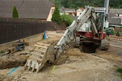 Сошник экскаватора на канаве - строить canalization Стоковая Фотография RF