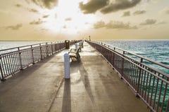 Солнечная пристань пляжа островов в заходе солнца Стоковая Фотография
