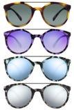 Солнечные очки изолированные на белизне в различных цветах Стоковые Изображения