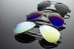Солнечные очки 3 пары Стоковая Фотография RF