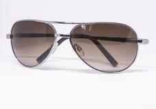 солнечные очки предпосылки белые стоковая фотография