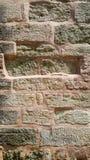 Солнечный свет на розовой каменной стене Стоковое Изображение