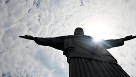 Солнце касаясь Cristo Redentor Стоковая Фотография