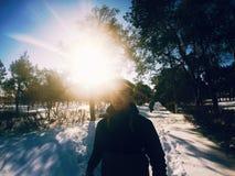 Солнце мальчика зимы Стоковое Фото