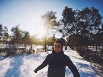 Солнце мальчика зимы Стоковая Фотография