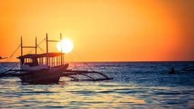 Солнце установило в Азию Стоковое Изображение
