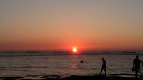 Солнце установило в реку Стоковая Фотография
