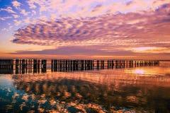 Солнце установило на залив Стоковая Фотография