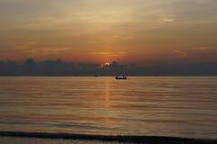 Солнце установило на море Стоковые Фото
