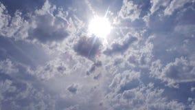 Солнце через облака Стоковое фото RF