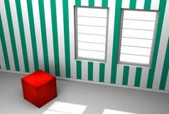 Красный кубик в комнате с зелеными обоями нашивки Стоковые Фото