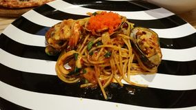 Спагетти с пряными продуктами моря Стоковая Фотография