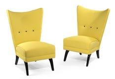 Спарите яркие желтые мягкие стулья изолированные на белизне Стоковое фото RF