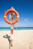 Спасательный пояс на пляже Стоковое Фото