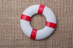 Спасатель или спасательный жилет на ткани Стоковые Изображения