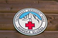 Спасение горы Logotyp - Tatra - добровольная ветвь (sluzba horska Tatranska - dobrovolny zbor) Стоковое Фото