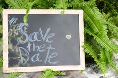 Спасение ` слово ` даты написанное на классн классном Стоковое Фото