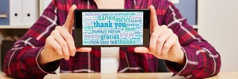 Спасибо в различных языках на smartphone Стоковая Фотография