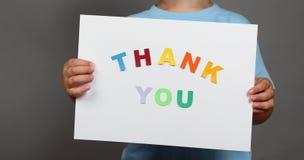 Спасибо подпишите внутри руки детей Стоковая Фотография