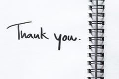 Спасибо сообщение на бумаге тетради Стоковое фото RF
