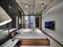 Спальня в стиле просторной квартиры Стоковое фото RF