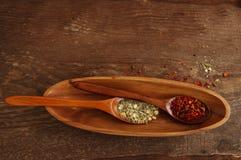 Специи в деревянных ложках Стоковое Фото
