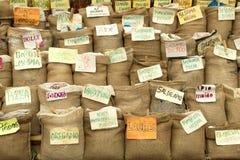 Специи и травы в сумках стоковое фото rf