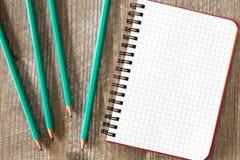 Спиральная тетрадь и карандаш 4 Стоковые Фото