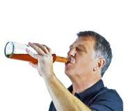 Спирт человека выпивая вне Стоковое Фото