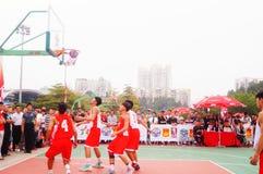 Спичка баскетбола 3 персон Стоковая Фотография RF