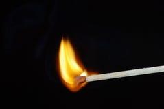 Спичка освещает вверх на предпосылке изолированной чернотой Стоковая Фотография