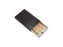 Спички в черном ящике изолированном на белой предпосылке Стоковое Изображение RF