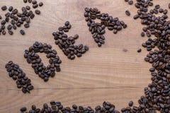 Спойте концепции идеи нарисованной среди зажаренных в духовке коричневых фасолей кофе Стоковая Фотография RF