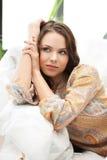 Спокойная думая или мечтая женщина Стоковая Фотография