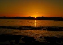 Спокойный заход солнца, сумрак, выравниваясь проливом Хуана de Fuka Стоковая Фотография