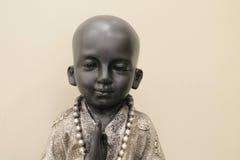 Спокойный мальчик Будда с светлой предпосылкой Стоковая Фотография RF