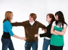 спорить девушки мальчика над предназначенный для подростков Стоковое Изображение RF