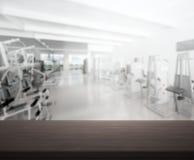 Спортзал фитнеса столешницы и нерезкости предпосылки Стоковые Фотографии RF