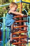 спортивная площадка мальчика Стоковая Фотография