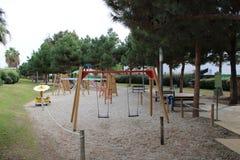 Спортивная площадка с качаниями на песке стоковое фото rf