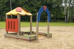 Спортивная площадка детей в дворе Стоковая Фотография