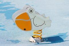 Спортивная площадка: пеликан езды детей стоковые изображения rf