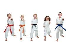 5 спортсменов в кимоно бьют руку пунша Стоковое Изображение RF
