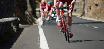 Спортсмены велосипедиста ехать гонка Стоковая Фотография RF