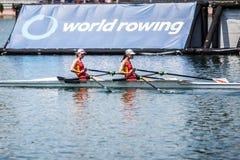 Спортсмены Швейцарии китайца на rowing конкуренции чашки мира гребя Стоковые Изображения RF