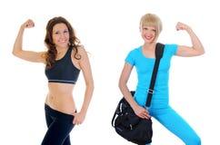 спортсмен красивейший демонстрирует мышцы девушки Стоковые Фото