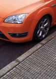 спорты автомобиля померанцовые припаркованные Стоковое фото RF
