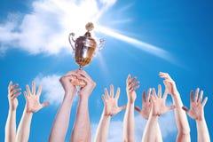 спорты персоны руки чашки Стоковые Изображения