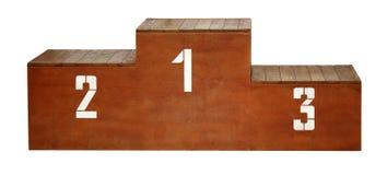 Спорт Деревянный подиум с белыми номерами стоковые изображения
