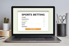 Спорт держа пари концепция на экране компьтер-книжки на современном столе Стоковое Фото